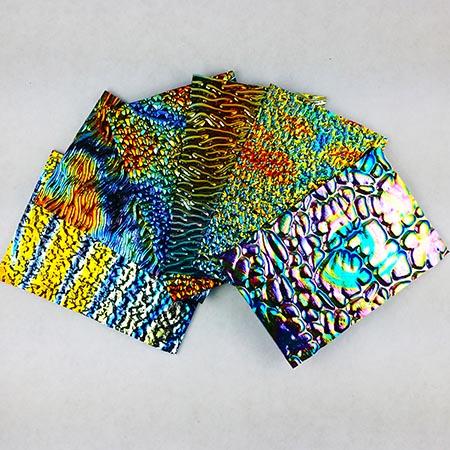 Dichroic Tie Dye patterns on Wissmach Textured Black System 96 1/2-lb Scrap